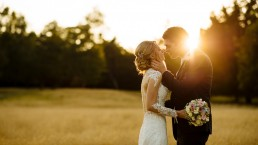 Pippingford Park wedding couple kissing in field