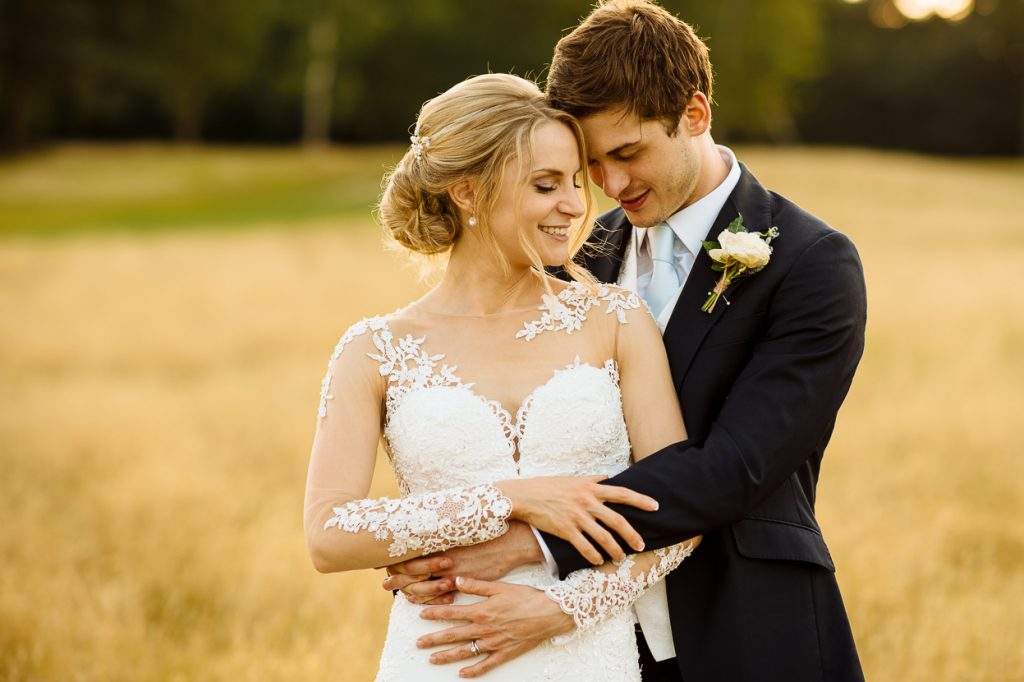 Pippingford Park wedding couple portrait in field