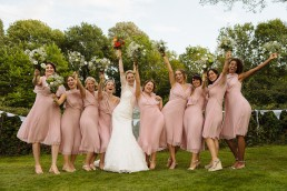 Four Oaks Farm wedding bride with bridesmaids