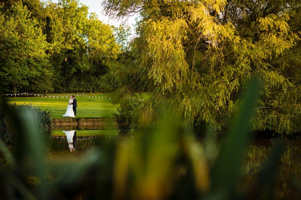 Four Oaks Farm wedding portrait by lake
