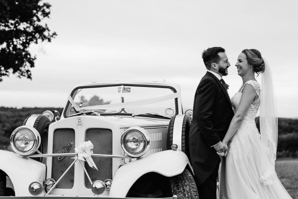 Henhaw Farm wedding bride & groom with classic car