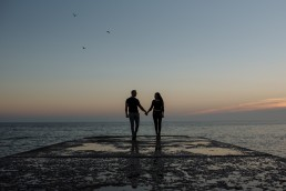 Brighton Beach pre wedding shoot couple at sunset