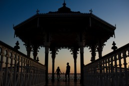 Brighton Beach pre wedding shoot couple at Bandstand