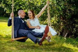 Brookfield Barn wedding bride & groom on swing