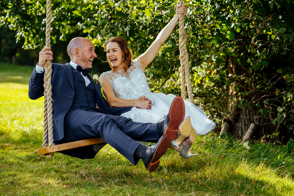 Brookfield Barn wedding bride & groom on swing