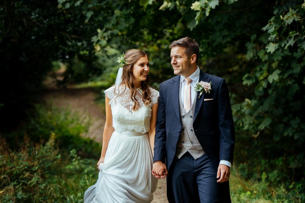 The Beacon, Tunbridge Wells wedding bride and groom walking