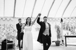 The Beacon, Tunbridge Wells wedding bride & groom entering marquee
